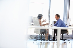 Two people talking in an office